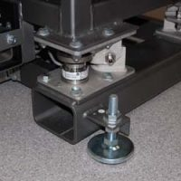 The vibrating table stands on load cells.